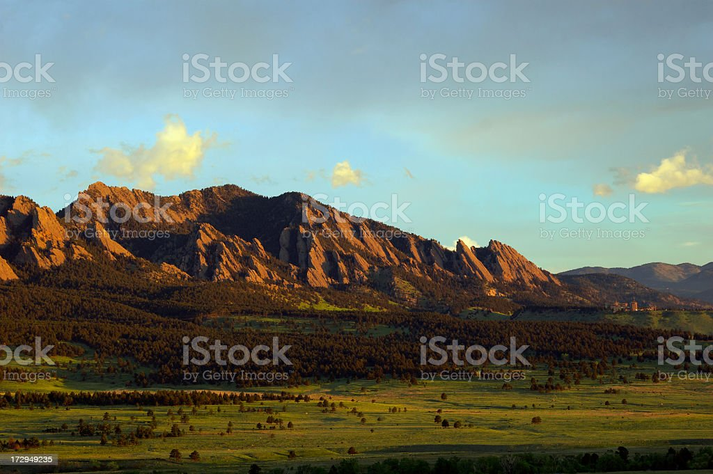 Landscape image of boulder flatirons and a lush field stock photo