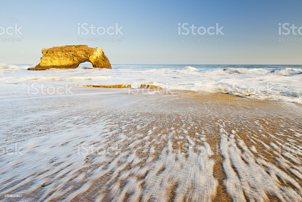A landscape image of natural bridges state beach stock photo