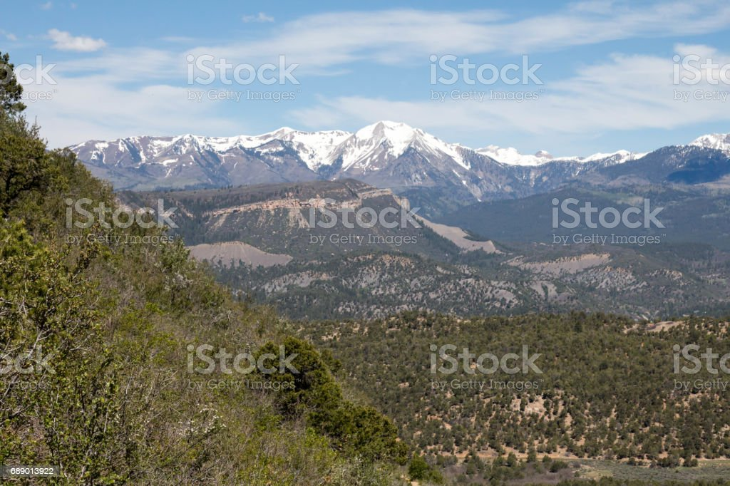 Landscape in Durango, Colorado - Pinion covered hills and snow capped mountains stock photo