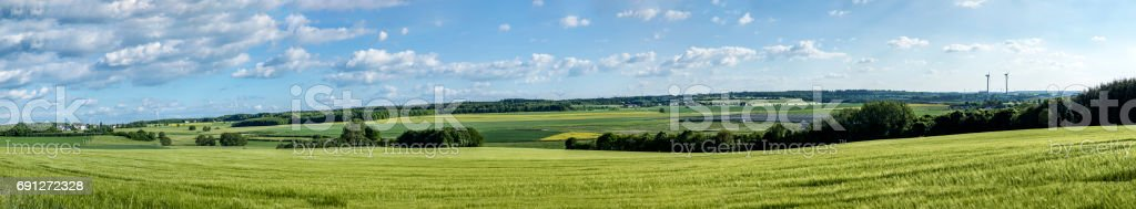 landscape in the Hunsrueck with wind generators and sun collectors stock photo