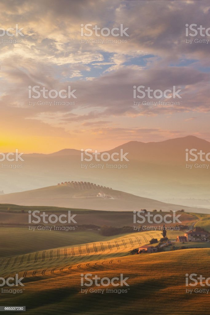 Landscape in Tuscany at sunrise stock photo