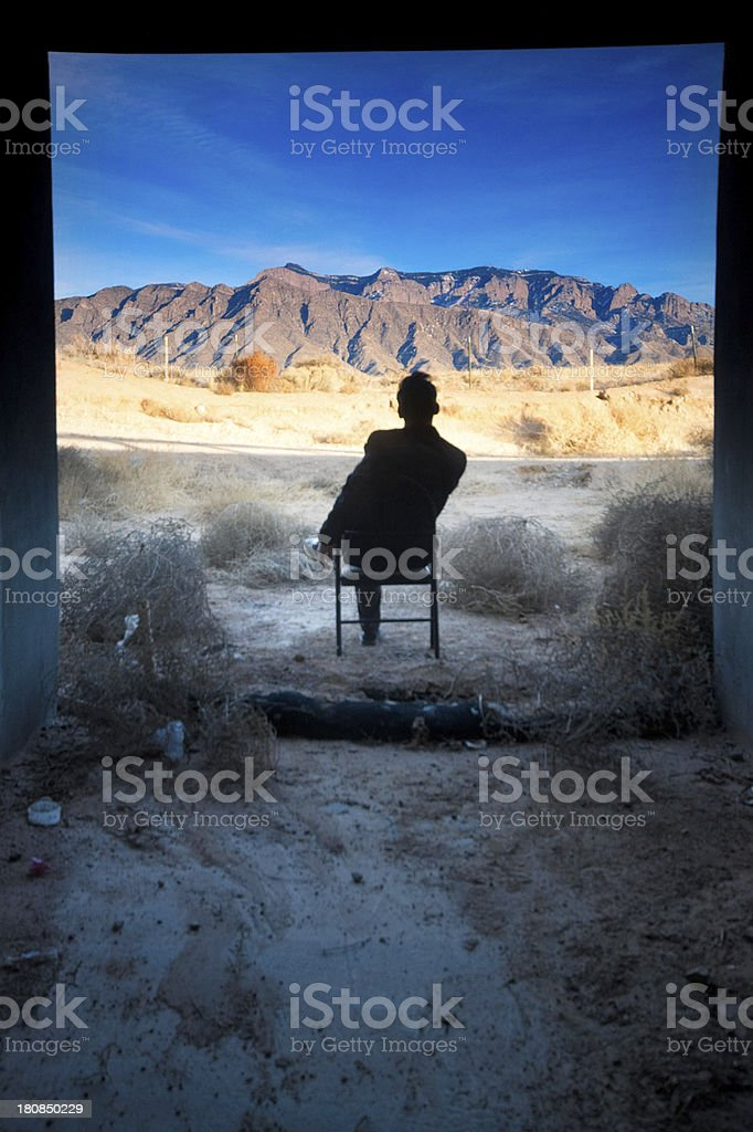 landscape man concrete sitting in chair royalty-free stock photo