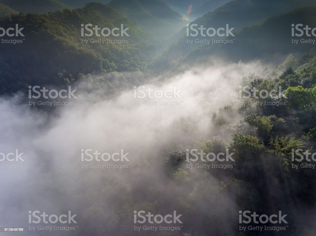 Landscape misty panorama. Fantastic dreamy sunrise on rocky moun stock photo
