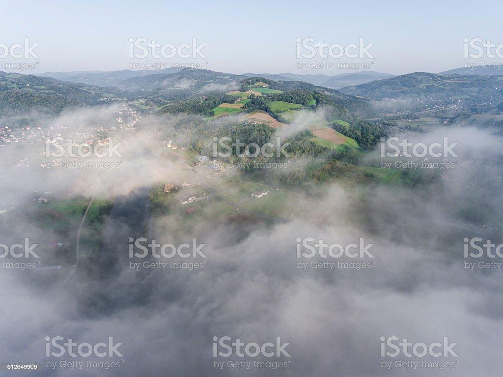Landscape misty panorama. Fantastic dreamy sunrise on rocky moun stock photo