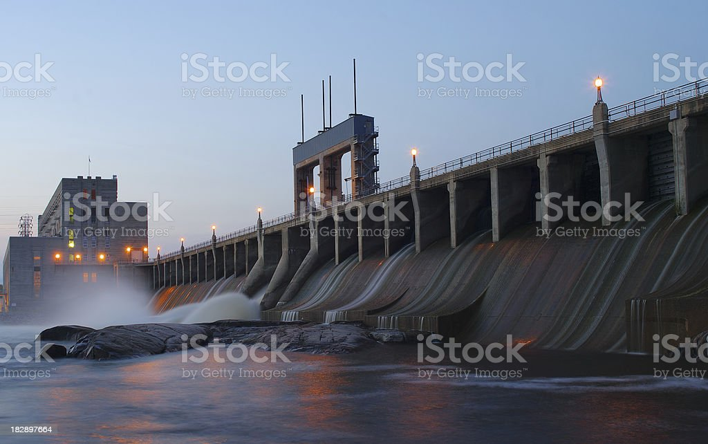 Landscape of a hydroelectric dam at dusk stock photo