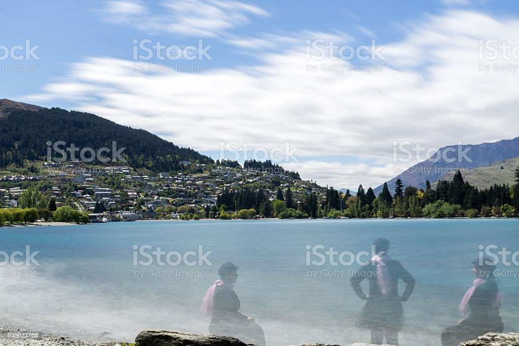 landscape of a mountains with lake with three clone woman stock photo
