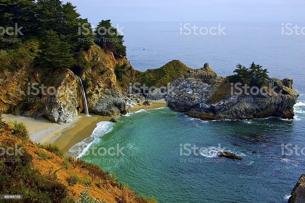 Landscape of a tropical beach waterfall stock photo