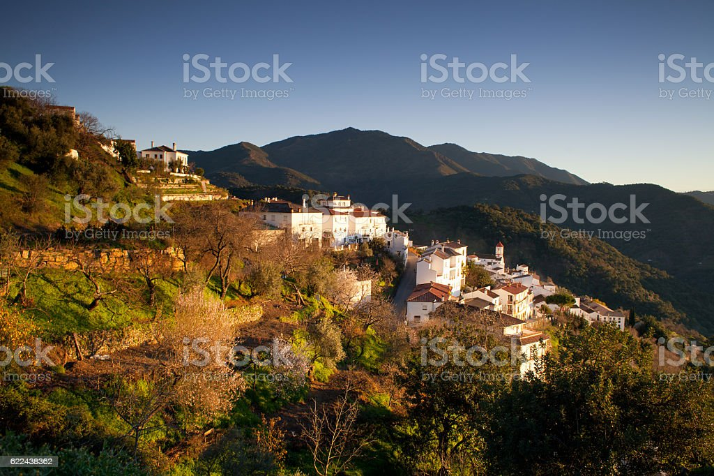 Landscape of Andalusian mountins and white village  in Spain stock photo