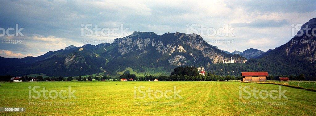 Landscape of Bavarian Alps with Neuschwanstein Castle in Bavaria, Germany stock photo