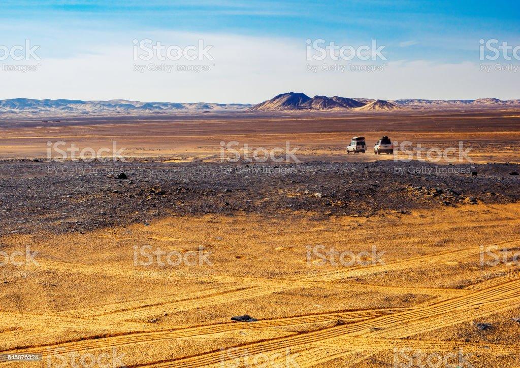 Landscape of Black Desert - safari tour in West Sahara at off-road cars, Egypt. stock photo