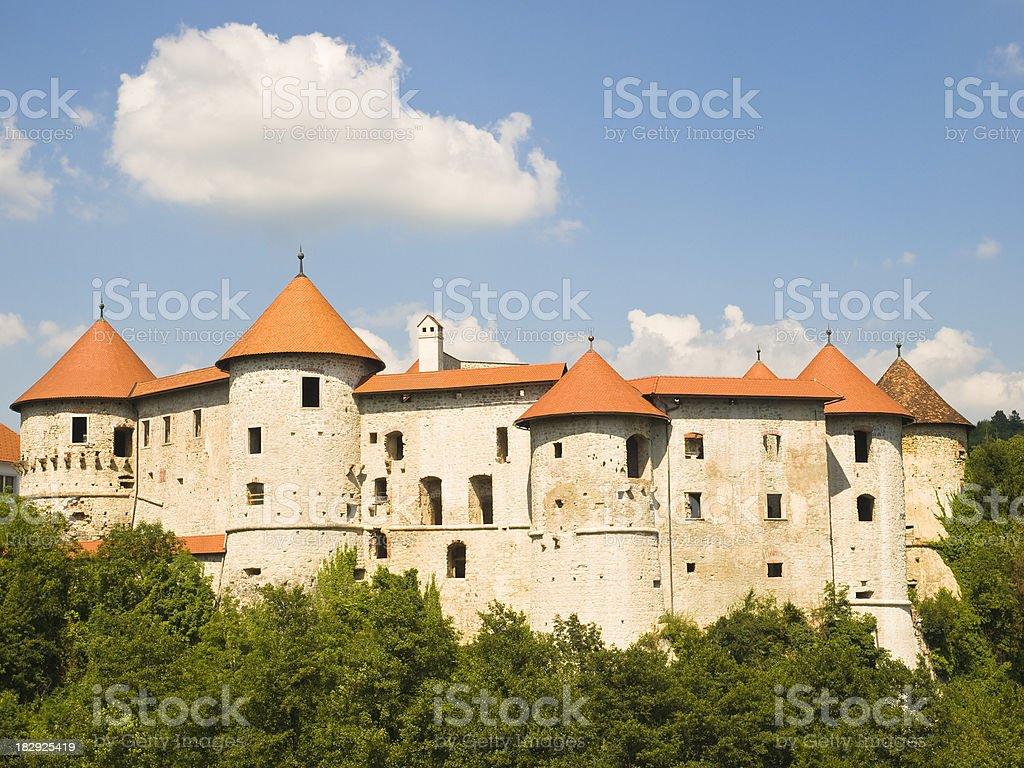 Landscape of Castle Zuzemberk with orange roofing and sky stock photo