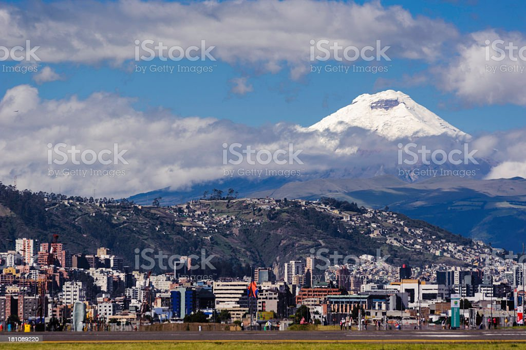 Landscape of Cotopaxi volcano with cityscape in front stock photo