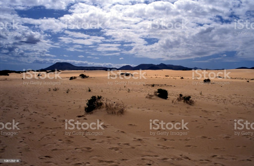 Landscape of Desert Against Blue Sky with Clouds royalty-free stock photo