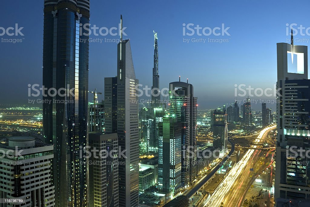 Landscape of Dubai skyscrapers and roads at night royalty-free stock photo