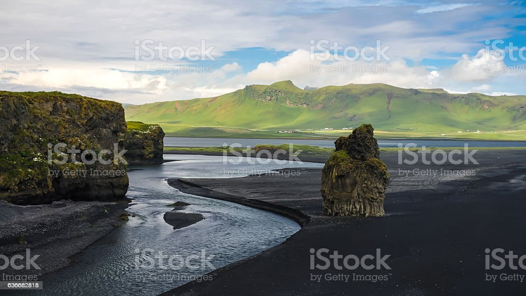 Landscape of Dyrholaey cape, volcanic sand beach South Iceland stock photo