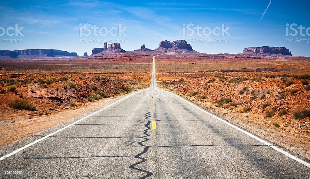 Landscape of highway leading forward into Monument Valley stock photo