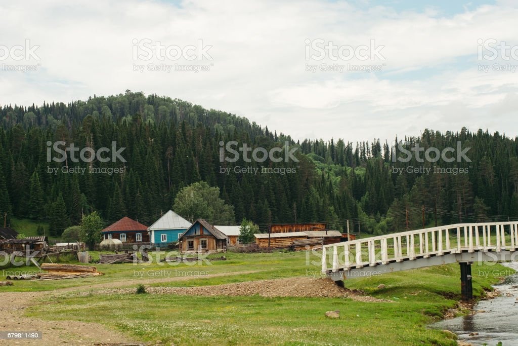 Landscape of houses located near mountains and forests. stock photo