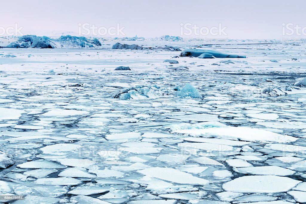 Landscape of ice:Frozen Jokulsarlon glacial lagoon in winter, Iceland stock photo