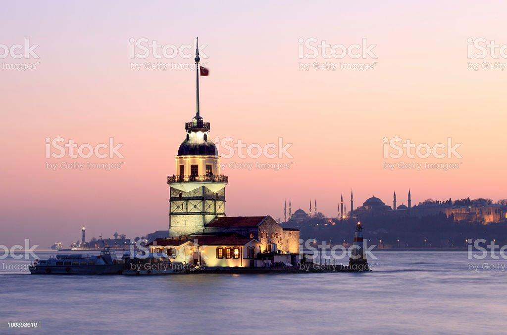 Landscape of illuminated Maiden Tower at sunrise royalty-free stock photo