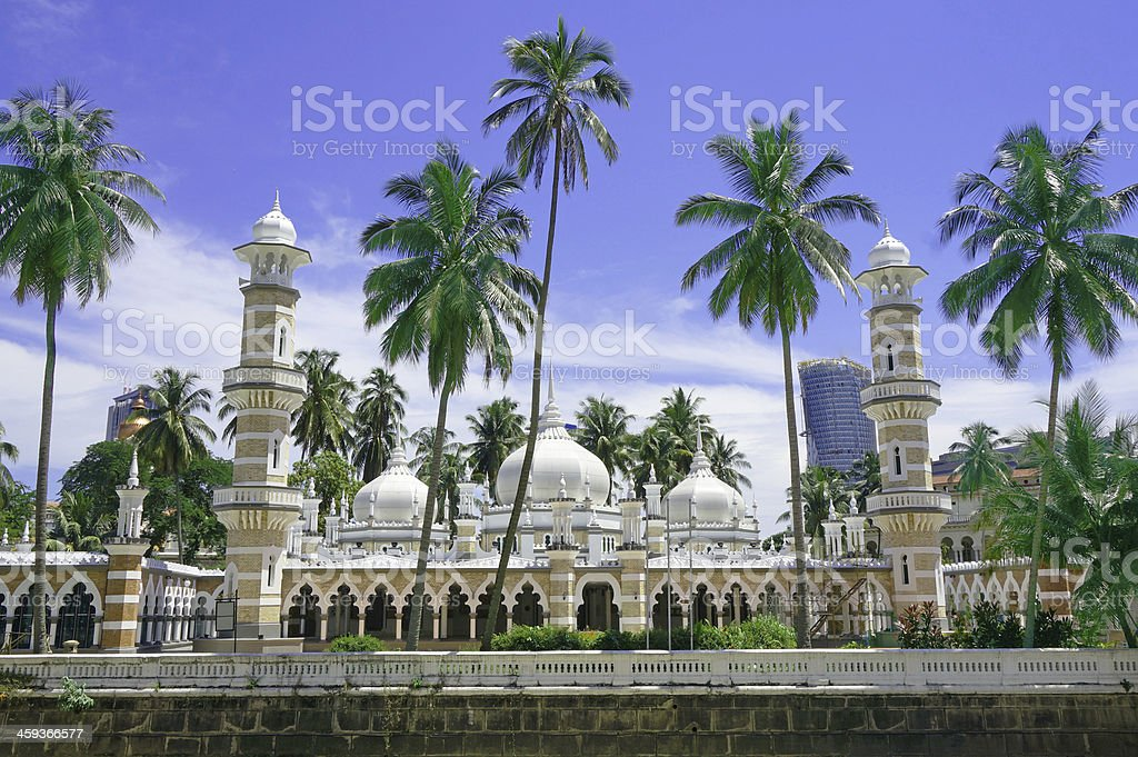 Landscape of Jamek Mosque, Kuala Lumpur with trees in front stock photo
