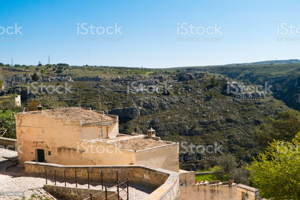 Landscape of Matera with hillside of prehistoric caves. stock photo