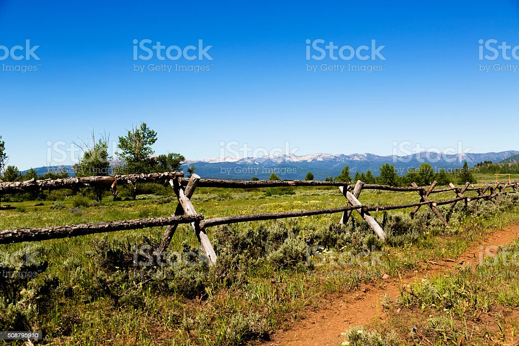 Landscape of Montana, USA mountains.  Old, wooden ranch fence. stock photo