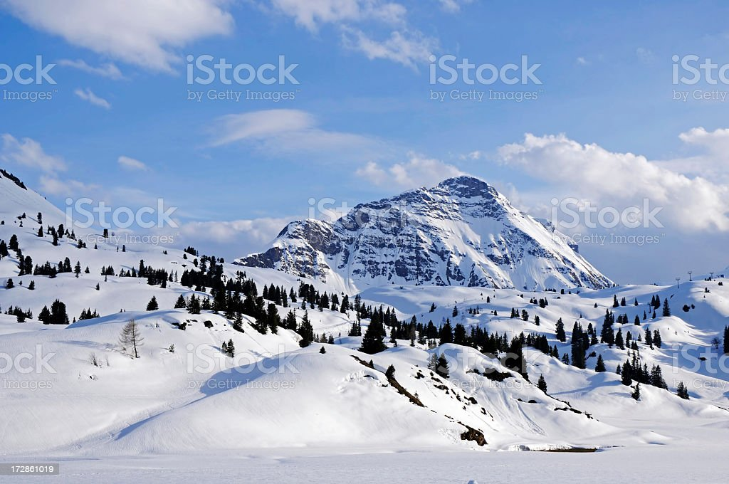 A landscape of mountains covered with snow royalty-free stock photo