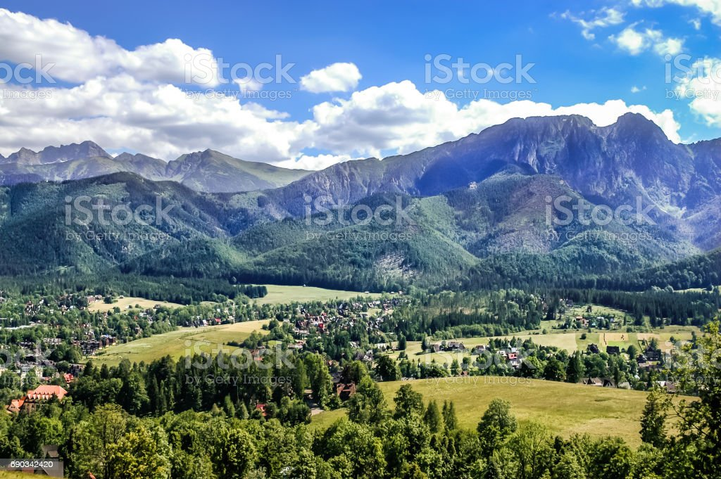 Landscape of mountains from the hiking trail to the top of mountain Gubalowka, view at valley Zakopane in the summer vacation stock photo