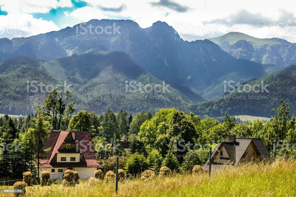 Landscape of mountains. Hay bales in the field in mountain village, Gubalowka slope, polish Tatra Mountains in the background, Zakopane, Tatra stock photo