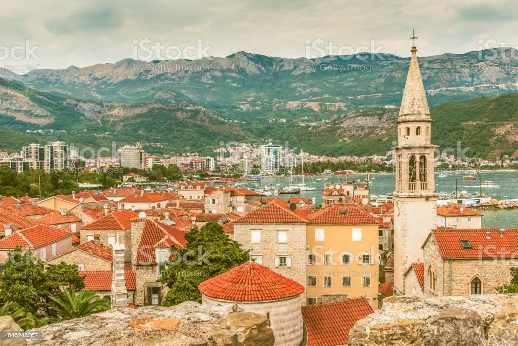 Landscape of Old town Budva: Ancient walls and red tiled roof. Montenegro, Europe. Budva - one of the best preserved medieval cities in the Mediterranean and most popular resorts of Adriatic Riviera. stock photo