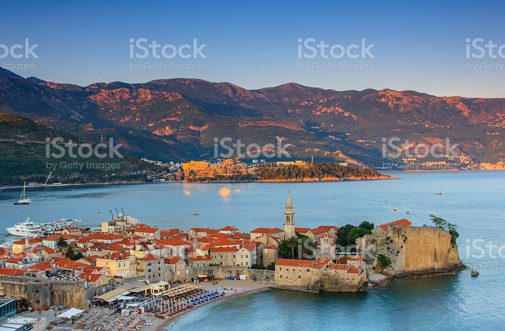 Landscape of old town Budva at sunset. Montenegro. stock photo