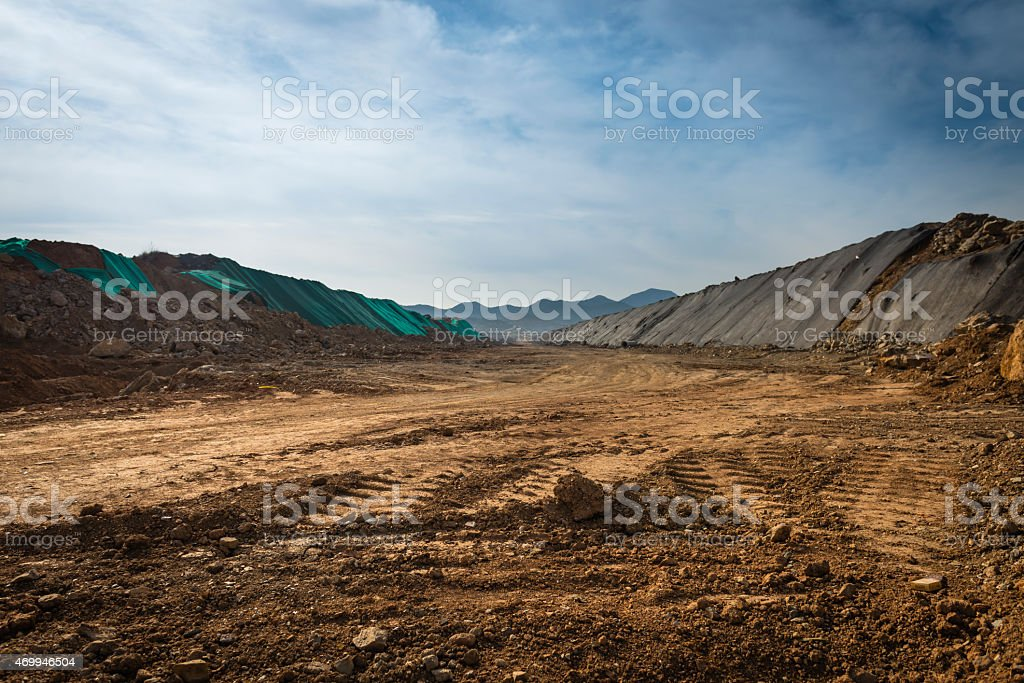 Landscape of open dirt field with off road tire tracks stock photo