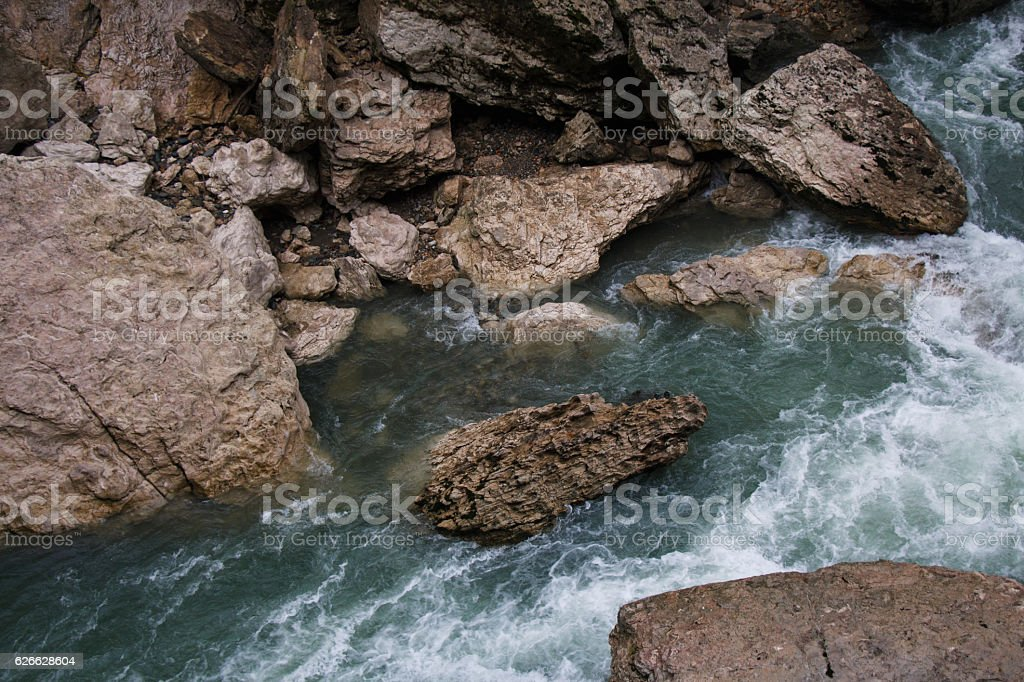 Landscape of rapid mountain river flowing between rough stones stock photo
