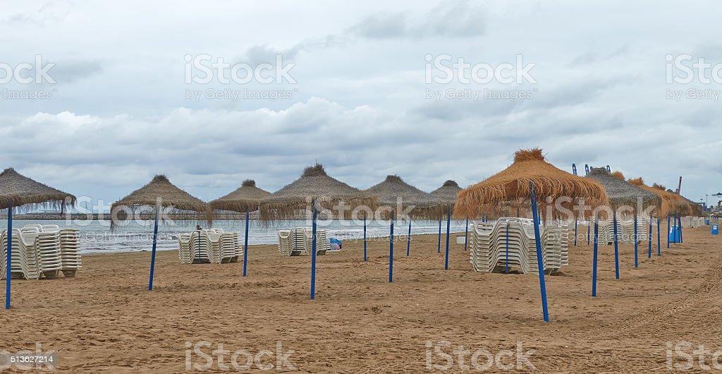 Landscape of sea beach with beach umbrellas. stock photo