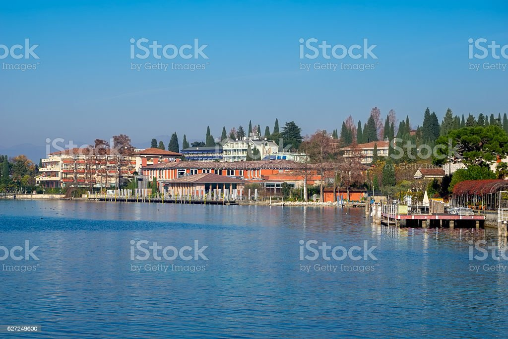Landscape of Sirmione with baths structure on Garda lake stock photo