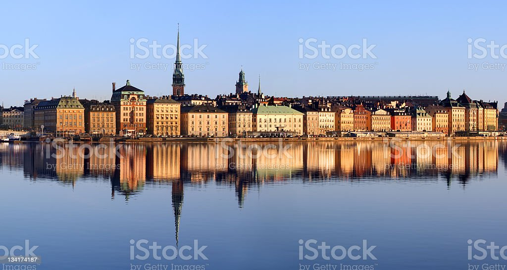 Landscape of Stockholm city behind a river on a clear day stock photo