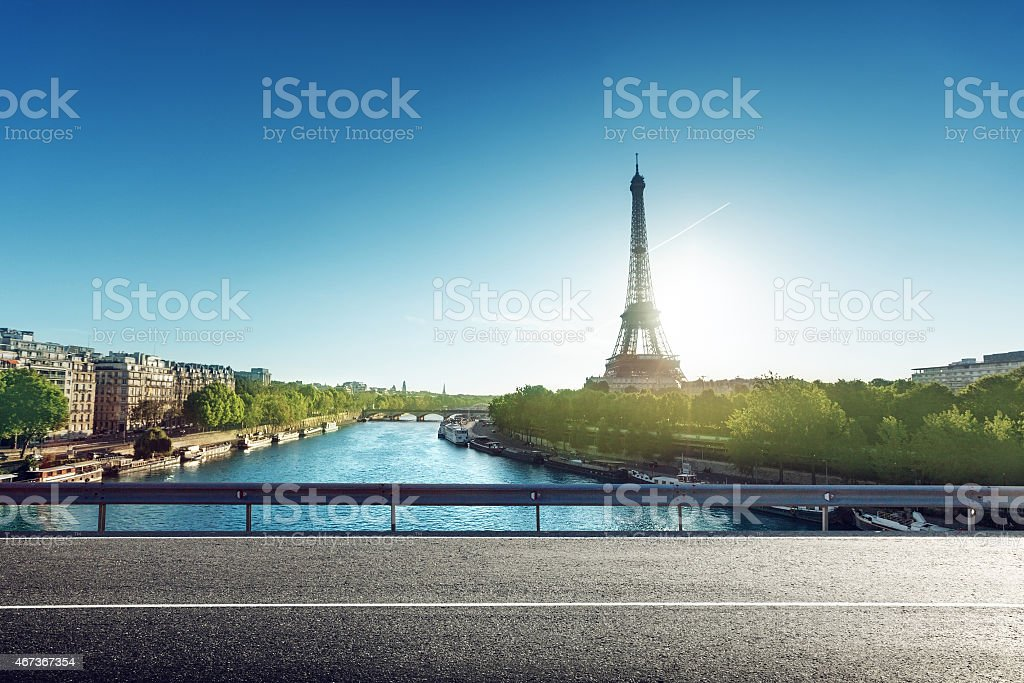 Landscape of sunny road with Eiffel Tower in the background stock photo