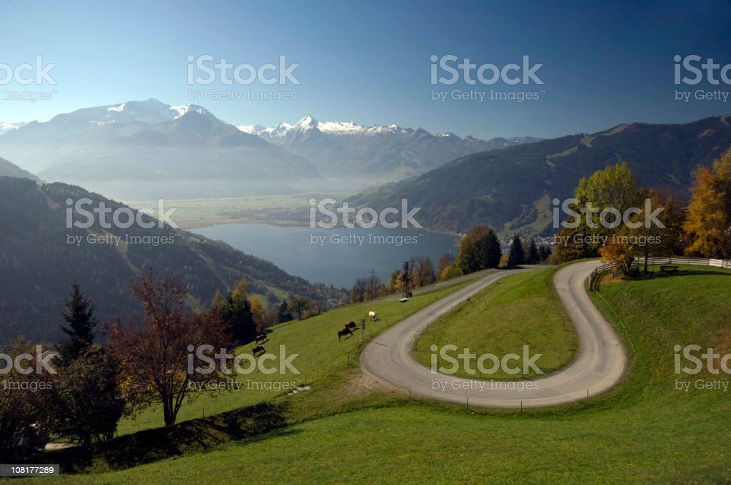 Landscape of Swiss Alps with Mountains, Lake and Farm royalty-free stock photo