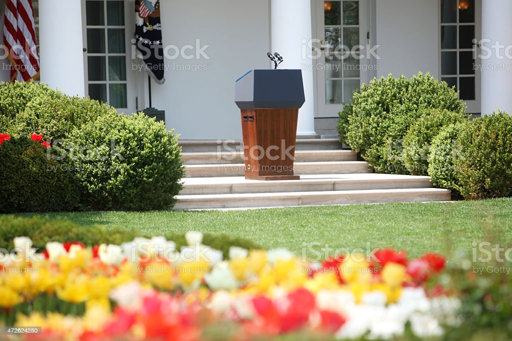 A landscape of the White House with flowers and bushes stock photo