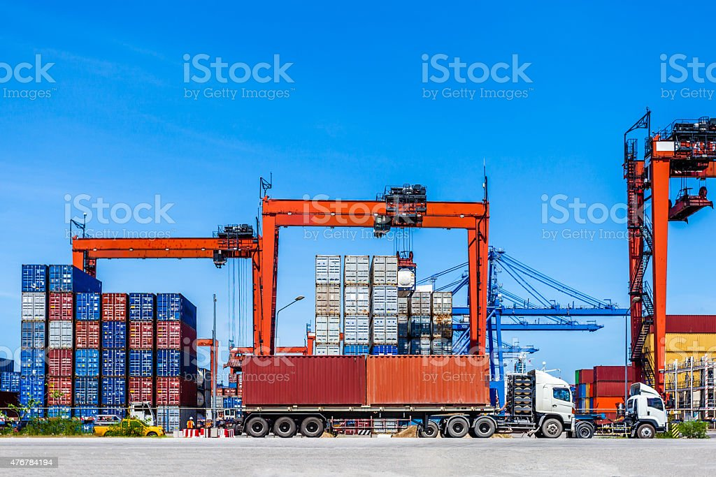 Landscape of truck, containers and crane at trade port stock photo