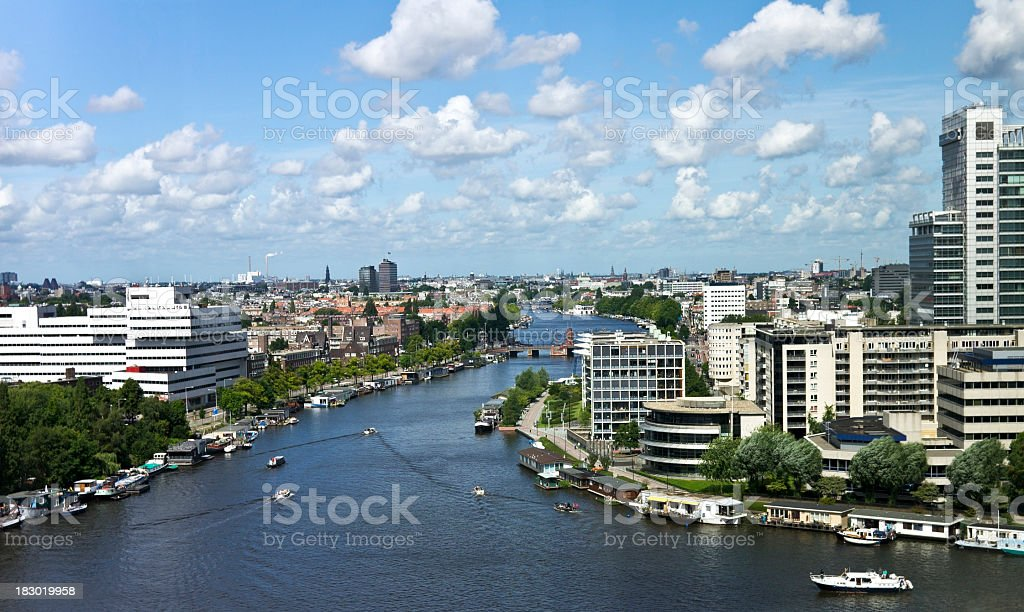 Landscape of water, buildings, and skyline in Amsterdam stock photo