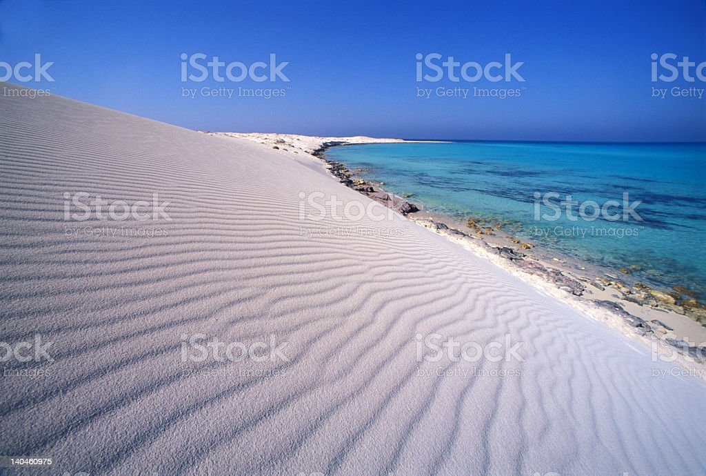 Landscape of white sand dunes and a coral reef royalty-free stock photo
