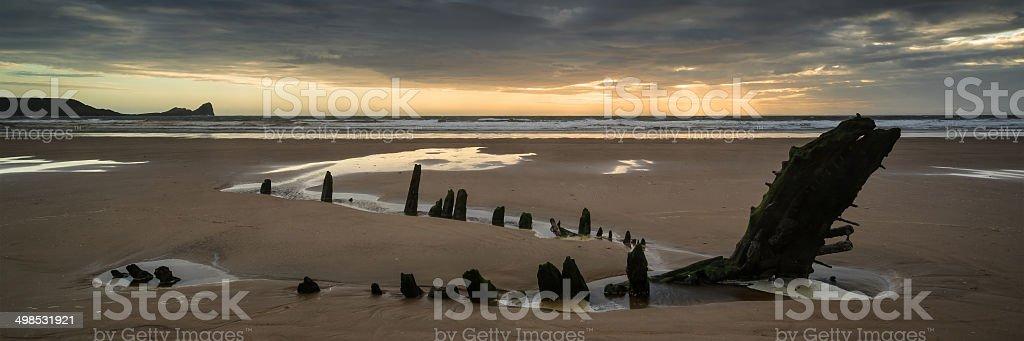 Landscape panorama ship wreck on Rhosilli Bay beach in Wales stock photo