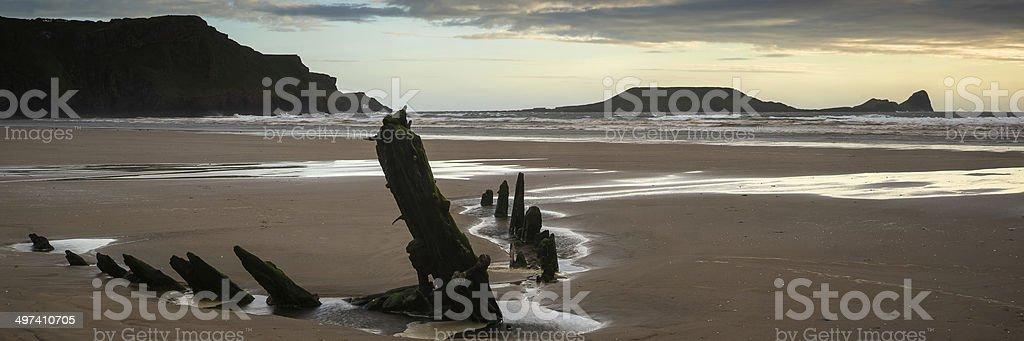 Landscape panorama ship wreck on Rhosilli Bay beach royalty-free stock photo
