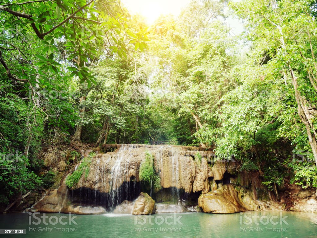 Landscape photo, Erawan Waterfall, beautiful waterfall in rainforest at Kanchanaburi province, Thailand stock photo