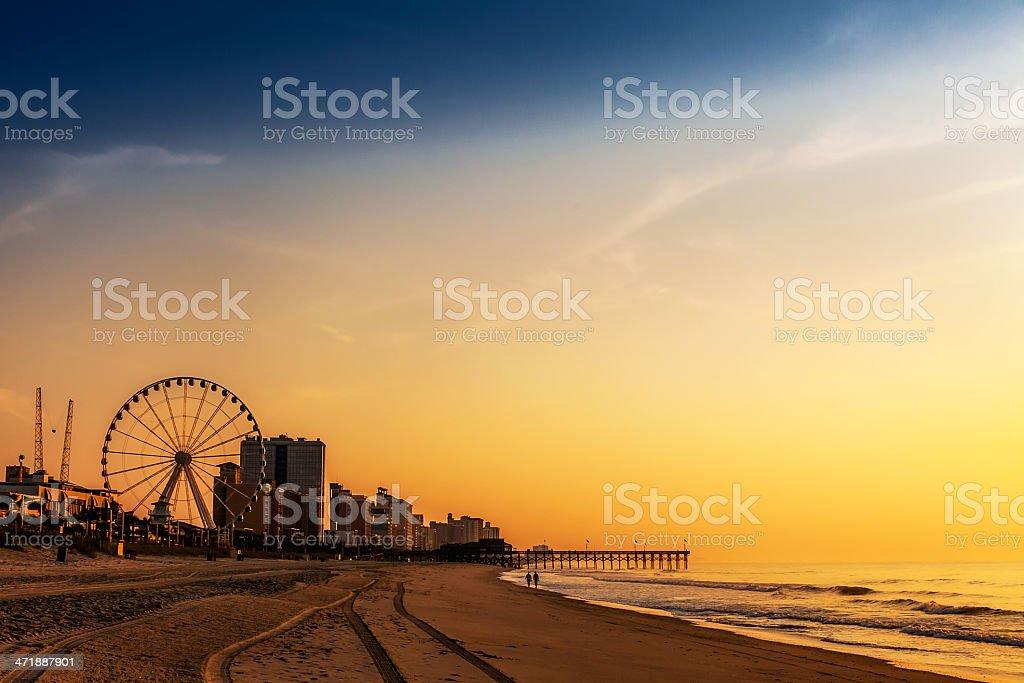 Landscape Photo Romantic SunriseSunset at Beach Resort stock photo