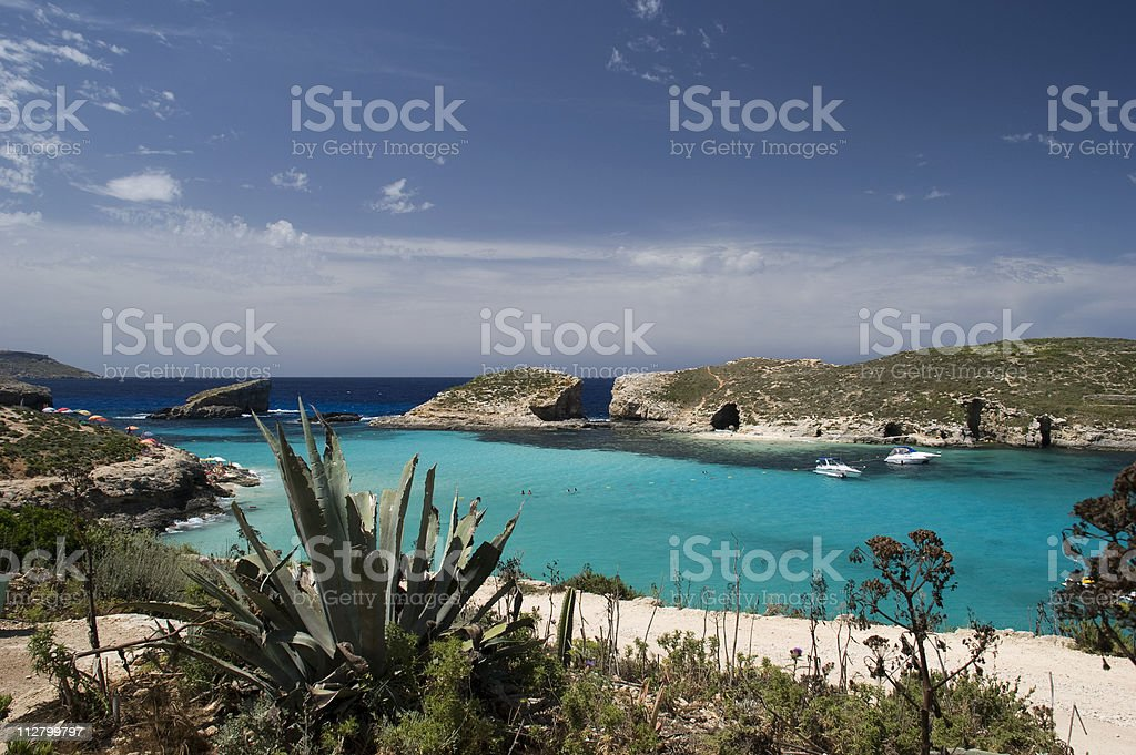 A landscape photograph of a blue lagoon in Malta royalty-free stock photo