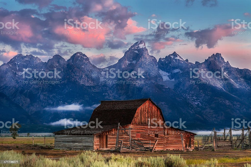 Landscape Photograph of Moulton Barn, Tetons in Magenta Morning Light stock photo