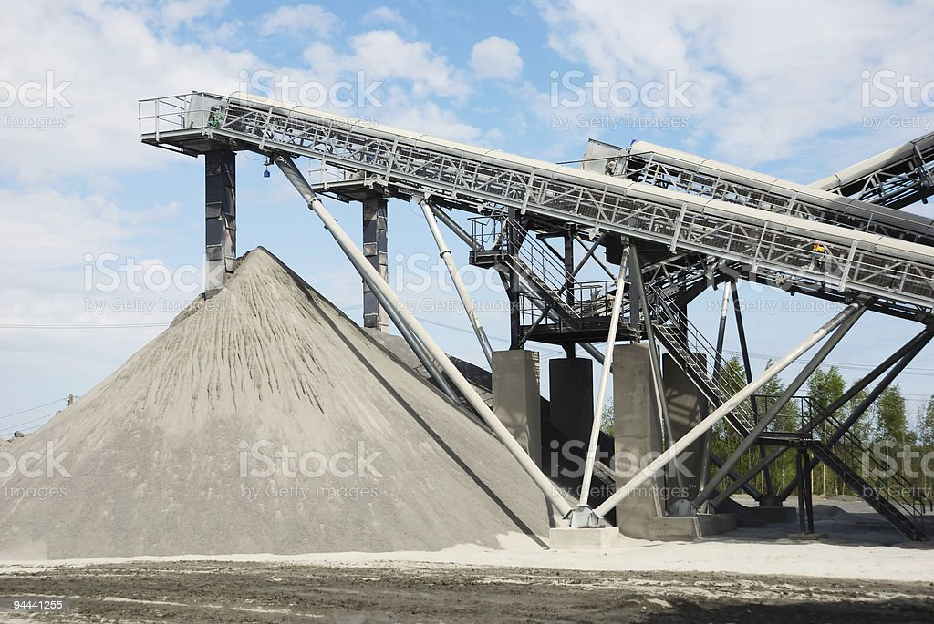 Landscape picture of stone quarry against a blue sky royalty-free stock photo