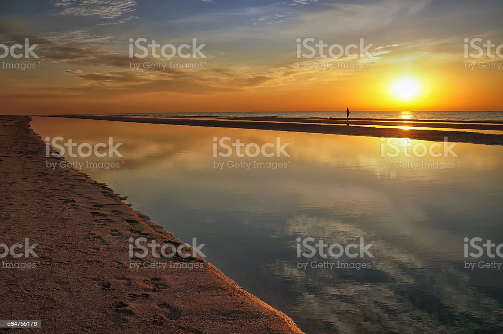 landscape pink sunrise over the sea in the early morning stock photo